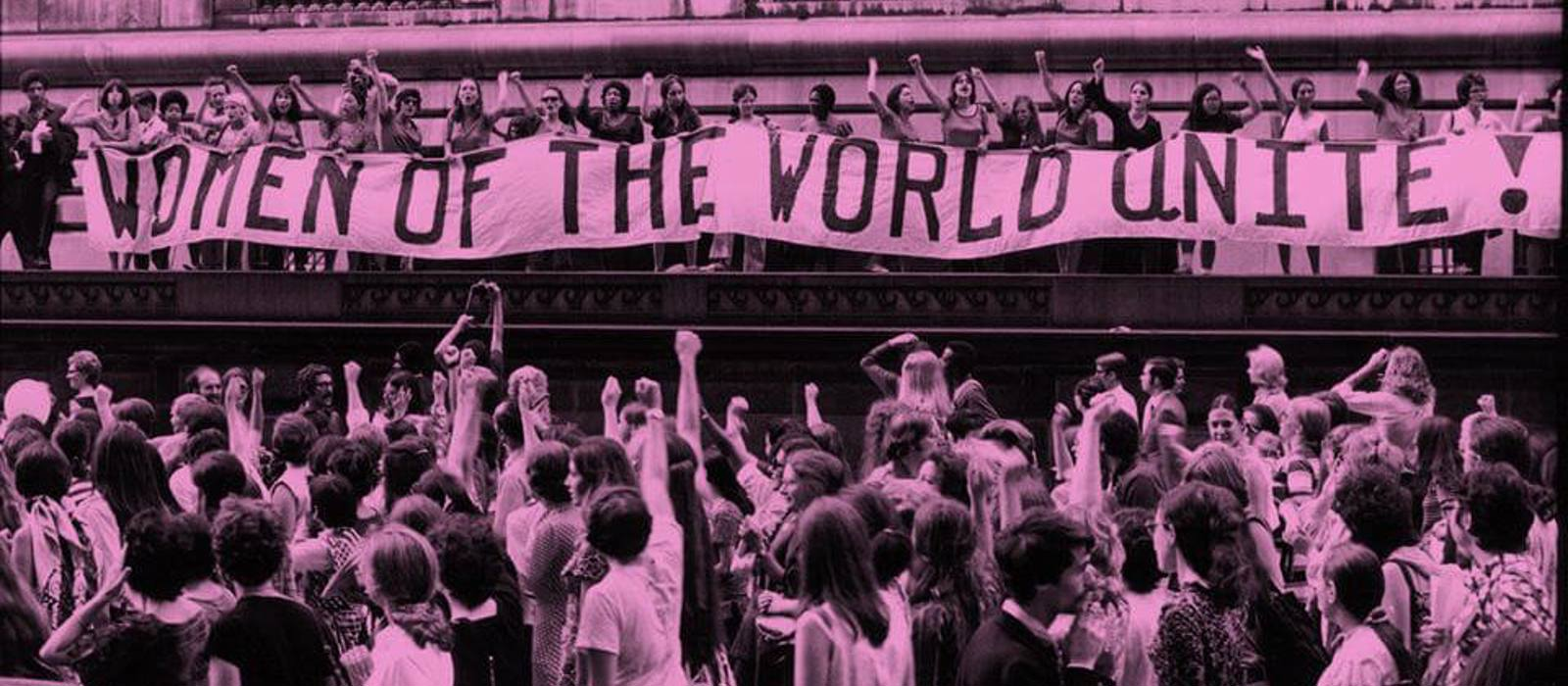 women of the world unite archive photo - protest banner and crowd